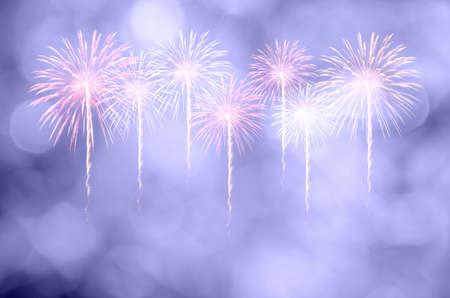 Colorful fireworks celebration and the twilight sky background with bokeh. Stock Photo