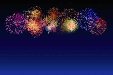 Colorful fireworks celebration and the twilight sky background. Stock Photo