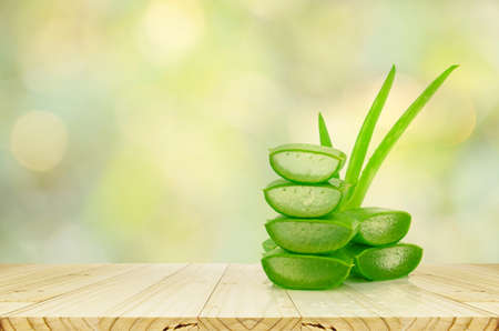 Aloe Vera on product display wood counter background. Archivio Fotografico
