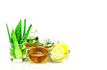 Aloe Vera, Lemon, greek yogurt, honey, rosemary, sea salt and essential oil homeopathy remedy recipe on white background.