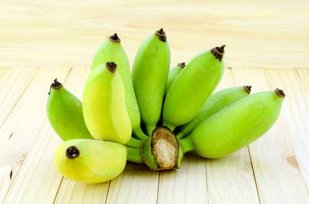Organic Asian Banana (Musa acuminata × Musa balbisiana Pisang Awak) on pine wood background. Stock Photo
