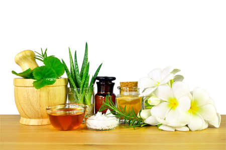Homeopathy, spa and natural care recipe on wood table and white background with clipping path.