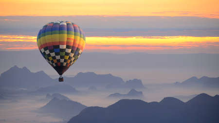 Hot air balloon over the sea of mist. Stock Photo