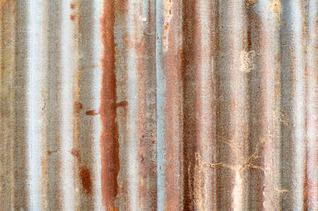 Closed-up of rusty galvanized iron steel plates wall for abstract texture background. Rusty corrugated metal texture surface or galvanize steel background.