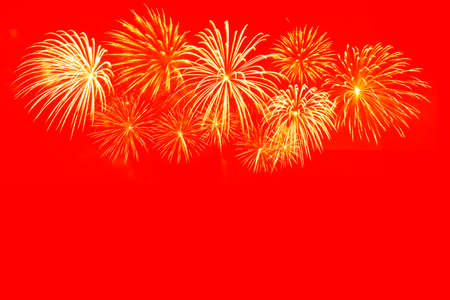 Gold fireworks celebration on red background for Chinese new year celebration.