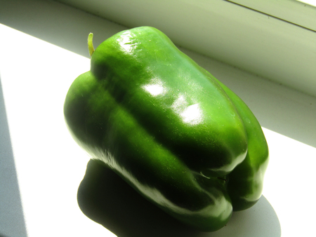 matures: Pepper on the window sill to charge with the suns rays and ripens salad Stock Photo