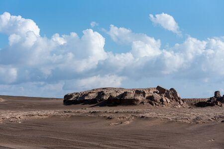 the wet sand stones in lut desert