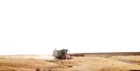 marivan, kurdistan-iran- july 27 2021, combine-harvester on isolated wheat field