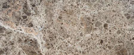 Hermosa superficie de mármol marrón con textura caótica de grava Foto de archivo - 85360978