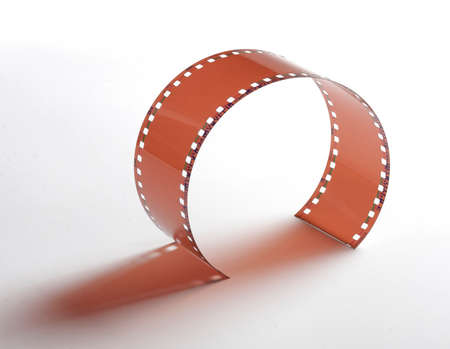 Photo of a segment of 35 mm coloured film isolated on a white background