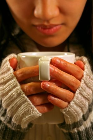 sip: A woman holding a cup of coffee