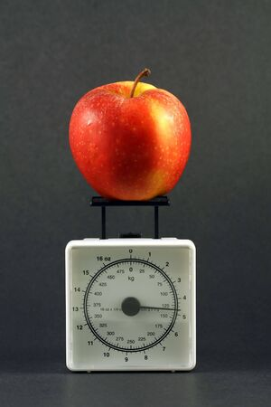 Apple on weight scale
