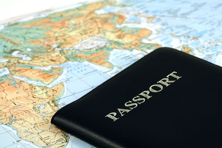 Travel with passport and map Stock Photo