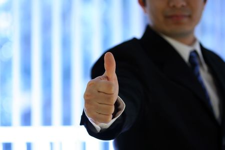 Businessman with his thumb up