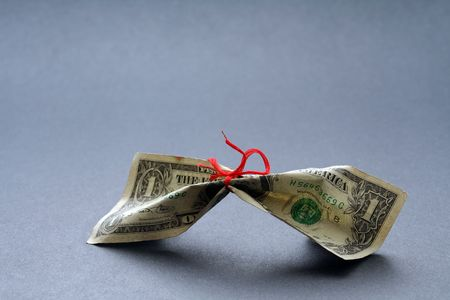 miserly: Money tied with a thread, symbolizes tight money or save money Stock Photo
