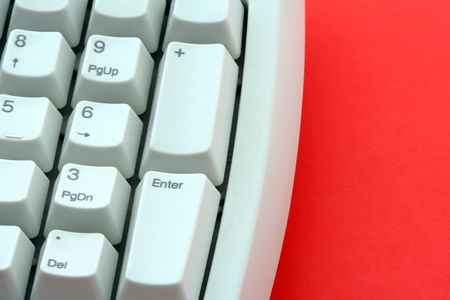 plainness: Computer keyboard on red