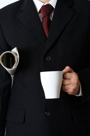 Businessman with newspaper and a cup of coffee