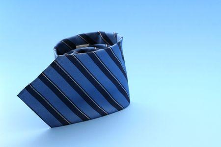 Blue tie against blue background