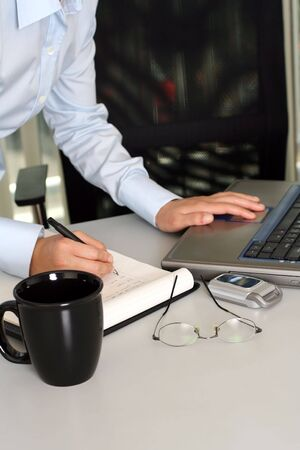 diligent: Businesswoman working on a laptop Stock Photo