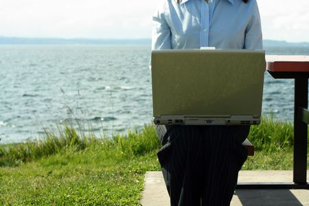 Businesswoman working outdoor near the beach