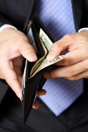 Businessman taking money out of his wallet