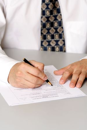 filling out: A business man filling out a form Stock Photo