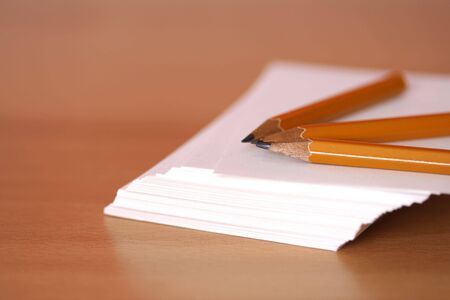 A stack of paper and pencils