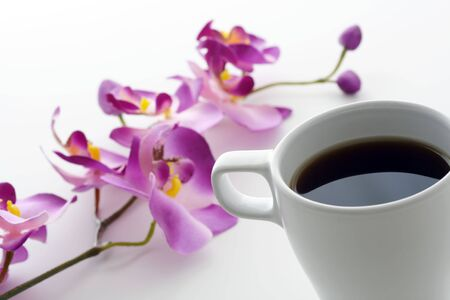 A cup of coffee and orchid