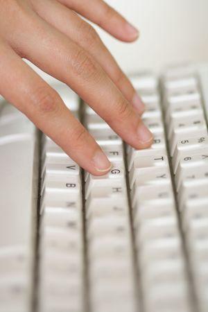 Hand touching on keyboard Banco de Imagens