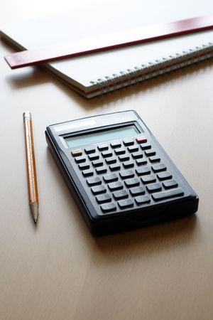 A calculator and a pencil, businessfinance concept 版權商用圖片