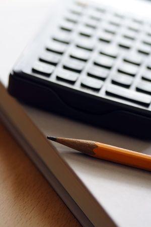 A pencil, calculator and book, for businessmoney concept 版權商用圖片