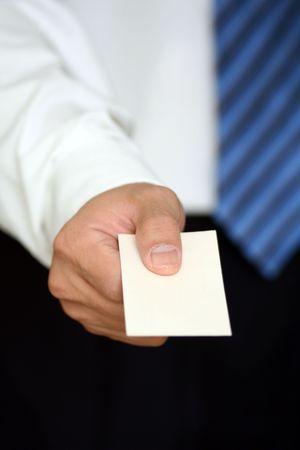 Businessman handing out a business card