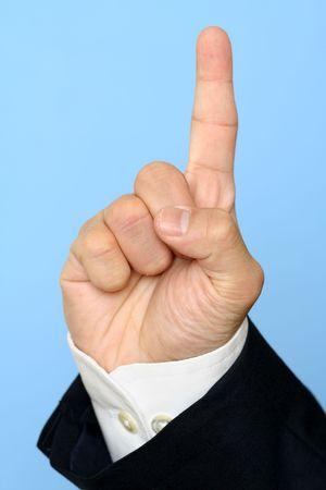 Businessman with raised index finger