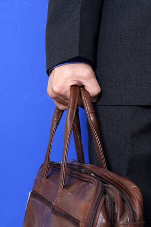 A businessman carrying a bag going to work