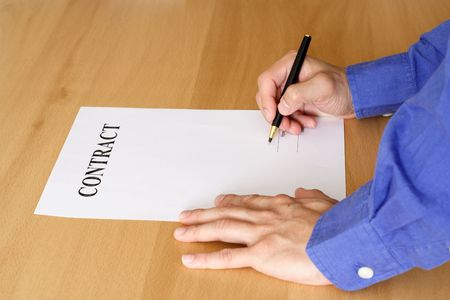 A businessman signing a contract or an agreement