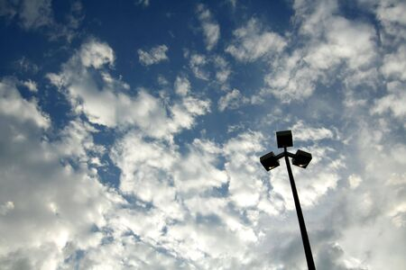Light pole and stormy clouds Stock Photo