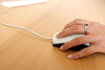techie: A businesswoman using a mouse