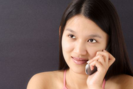 A pretty woman talking on her cell phone Stock Photo - 463652