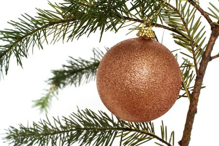 Gold Christmas ornament hanging on a tree photo