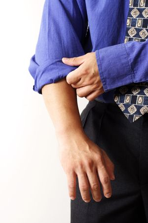 A businessman rolling up his sleeves photo