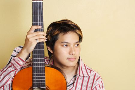 A handsome man holding a guitar Stock Photo - 499447