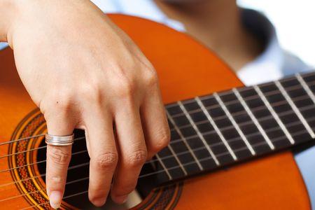 resonate: A guitar player strumming his guitar