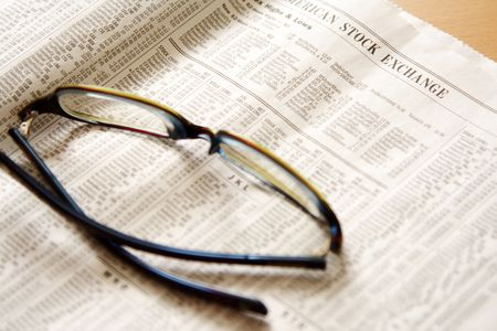 Reading stock prices on newspaper Stock Photo - 507238