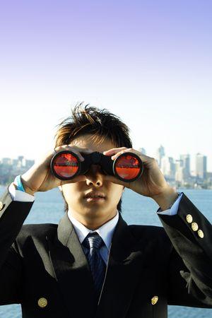 Businessman looking through binoculars, can be used as visionprospect metaphor