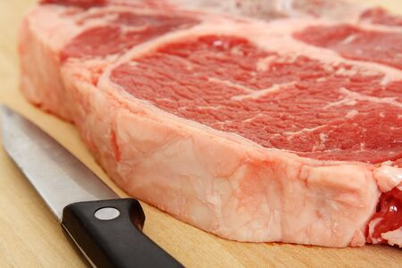 Close up of a ribeye steak and a knife Stock Photo