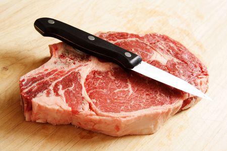 A piece of raw ribeye steak Stock Photo