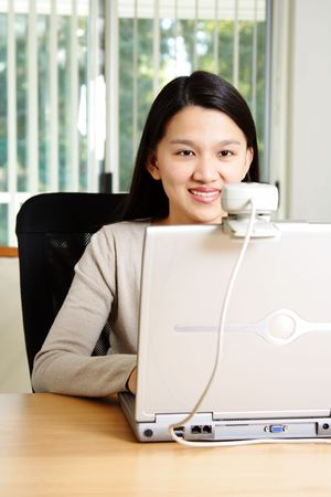 A businesswoman using webcam to communicate