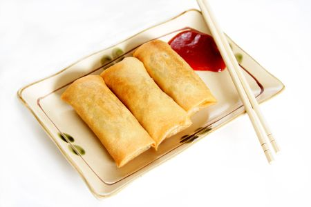 Three crispy fried egg rolls photo