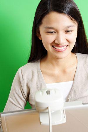 telecommute: A businesswoman using a webcam