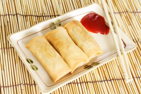 Crispy egg rolls on a plate photo